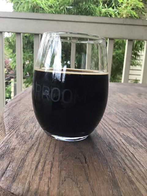 Breakside brewing's Chocolate Brandy Alexander in glass on table outside.