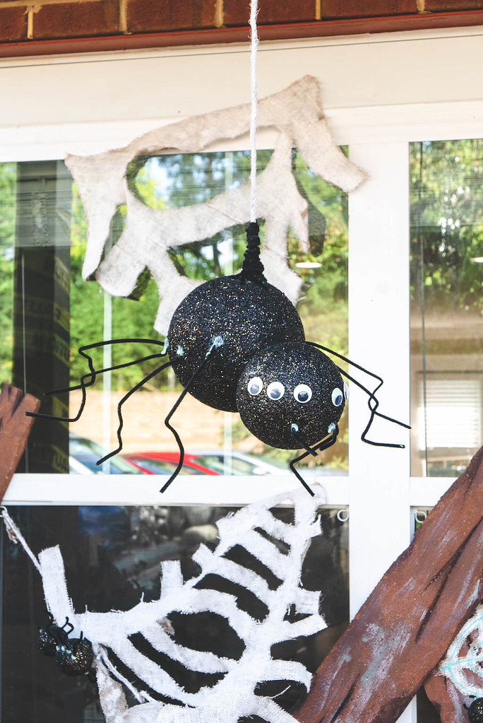 A big spider decoration hanging from a rope.