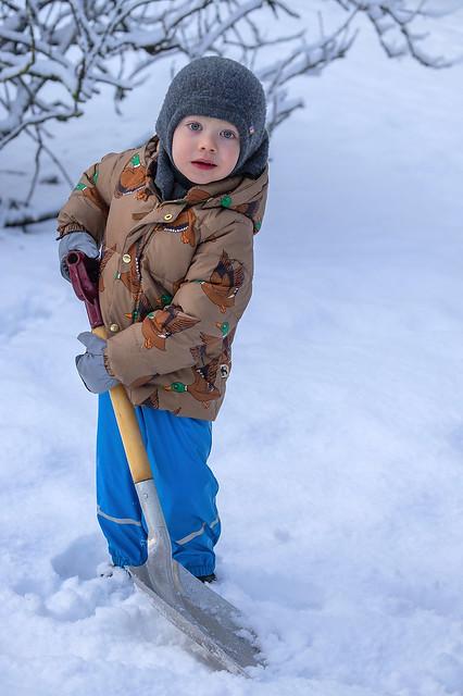 My grandson Nói shoveling the snow