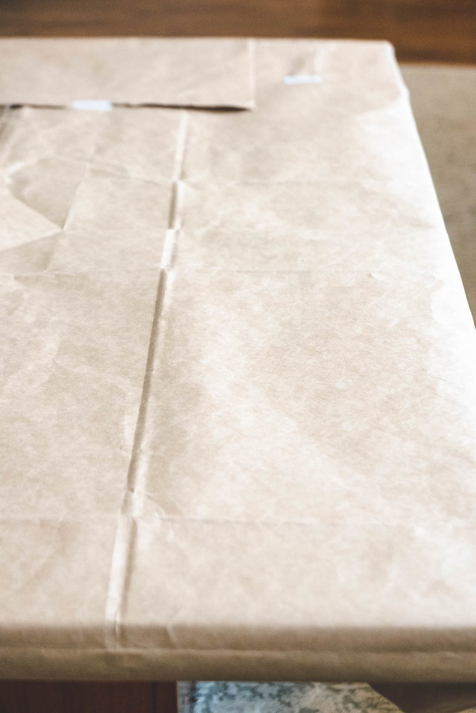 Paper placed over a table to start crafting