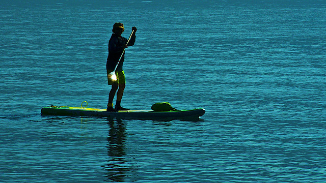 Aboard Her Paddle Board