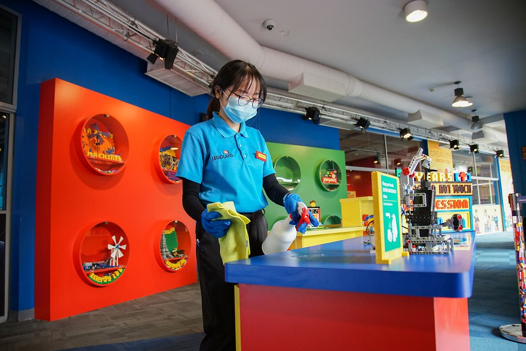 LEGOLAND Malaysia Resort Team member preparing their stations in anticipation of reopening.