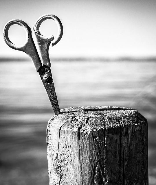scissor in a post