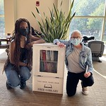 Taylor L. McCabe and Tomma Guastaferro with the Little Free Library at the WFU Wellbeing Center