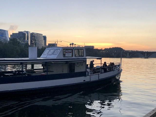 Nightingale boat arriving at sunset, Potomac River at Washington Harbour, Georgetown, Washington, D.C.