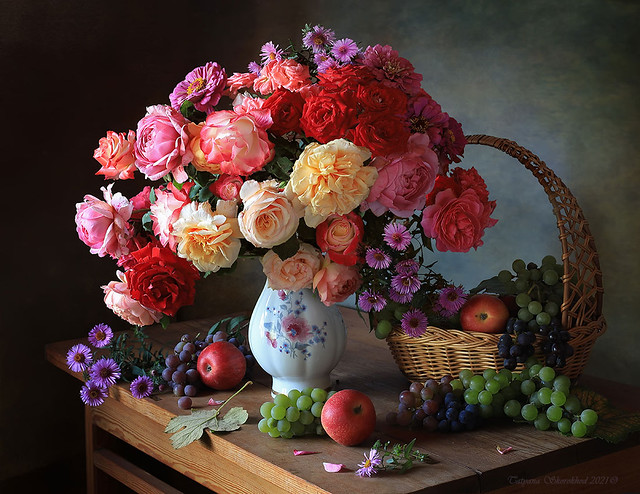 Still life with autumn roses and grapes