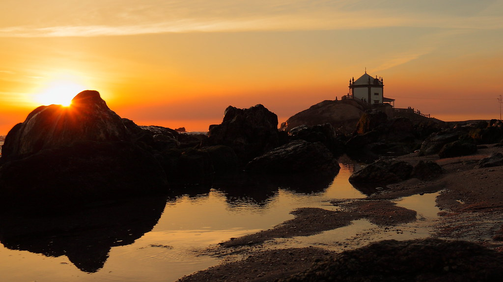 Sunset behind rock