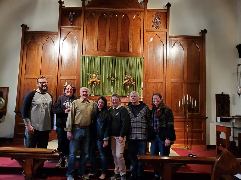 Pictured from left to right: Kris Thompson (Head Brewer), Janelle Buttery (Taproom Manager), Jay Clancey (Owner), Lydia Kelsey Bucklin (Episcopal Diocese of Northern Michigan), Ginny Graybill (Priest, Grace Church), Bill DeWitt (Deacon, Grace Church) May
