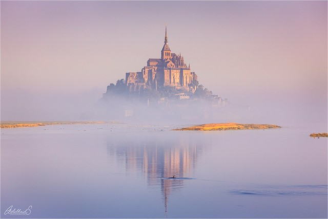 Mont St Michel in early morning fog, France