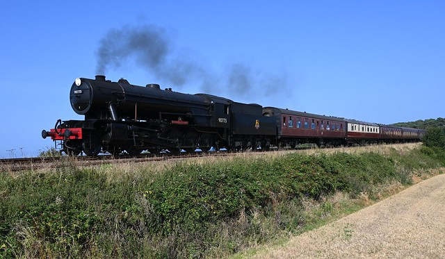 WD Austerity No.90775 heads the 14.14 Sheringham - Holt service towards Weybourne in brilliant sunlight. North Norfolk Autumn Steam Gala. 05 09 2021