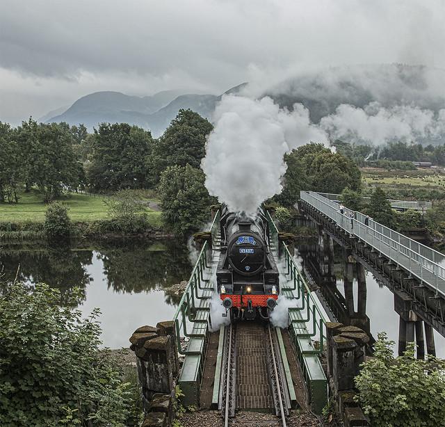 Jacobite steam train crossing River Lochy Caol Fort William Lochaber