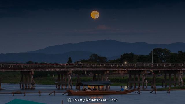 Watching the Harvest Moon rising over the Togetsukyō Bridge in Arashiyama.