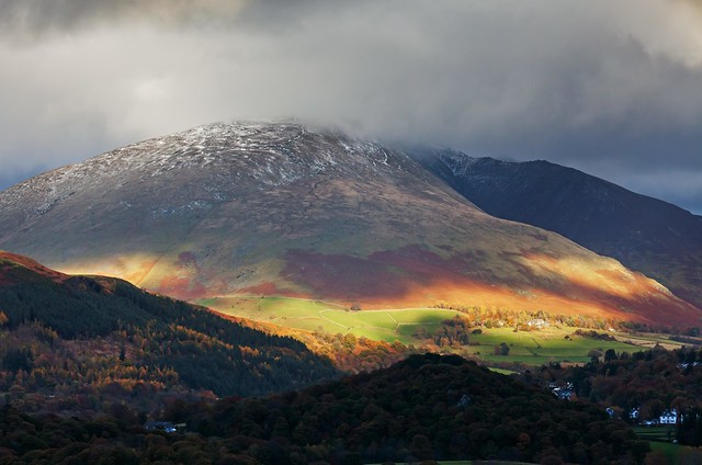 A shaft of sunlight dapples the slopes of Blencathra on a cloudy day