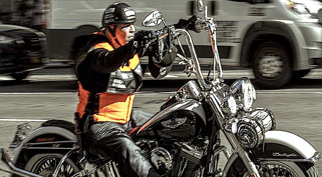 Biker Racing Down 7th Avenue in Manhattan