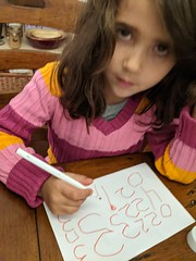 Practicing her numbers