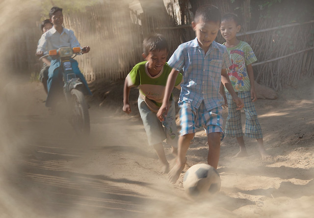 Playing football in the dust , Bagan , Myanmar