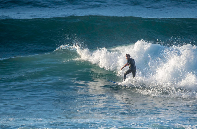 Surfs up early morning surfer