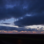 17. September 2021 - 20:13 - Dramatic sunset with dark clouds over the waddensea of the southern North Sea near Cuxhaven-Duhnen (Germany, Lower Saxony)