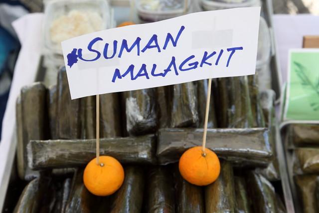 Suman malagkit, handwritten sign with orange sign holders, Emz Native Delicacies, Araw ng Aruga Filipino Festival, Corpus Christi Parish, Woodside, Queens