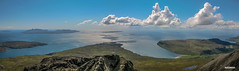 Incredible summit view from Sgurr Alasdair, highest point on the 6,000 offshore islands of Britain. Left to right, Isles of Eigg, Soay, Rum, Sanday, Canna and Outer Hebrides. Glenbrittle and beach, bottom right.