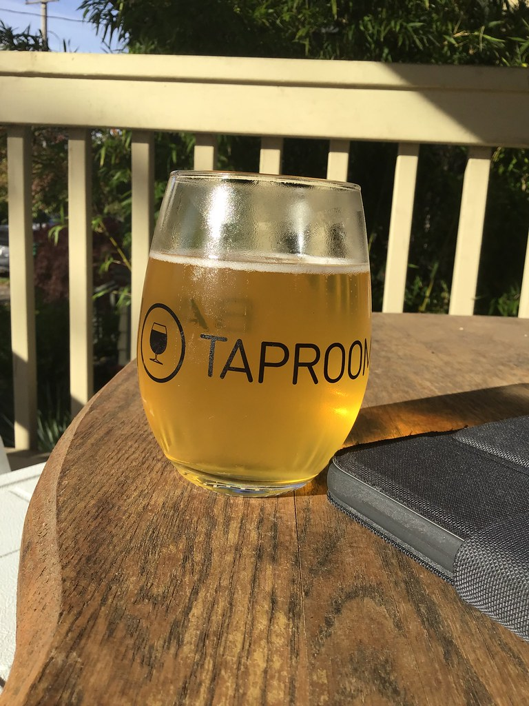 New Spring brewing white ale in glass, outside on table