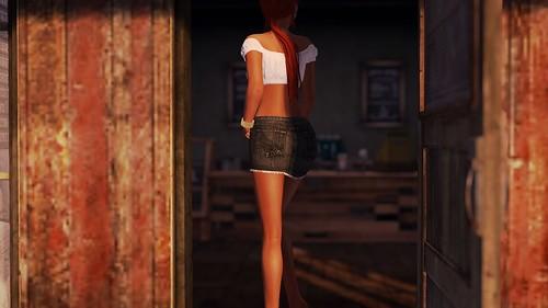 Standing in the shadow of a doorway