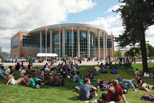 Students on grass outside International Building