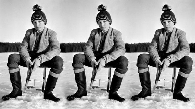 Swedish lad out icefishing at Öjungsnappet 05-04-1964