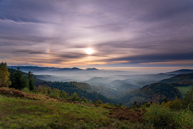 Dreamlike autumn sunset with a 22° halo and two sun dogs over the Murgtal in the northern Black Forest