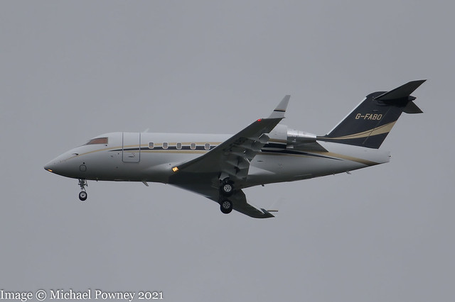 G-FABO - 2001 build Bombardier Challenger 604, on approach to Runway 23R at a grey, overcast Manchester