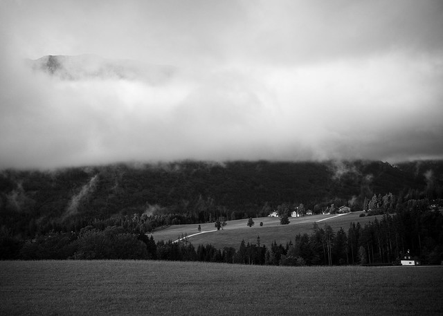 Foggy mountainscape with house