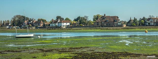 Classic Bosham Creek, Chichester Harbour, West Sussex, in panorama.