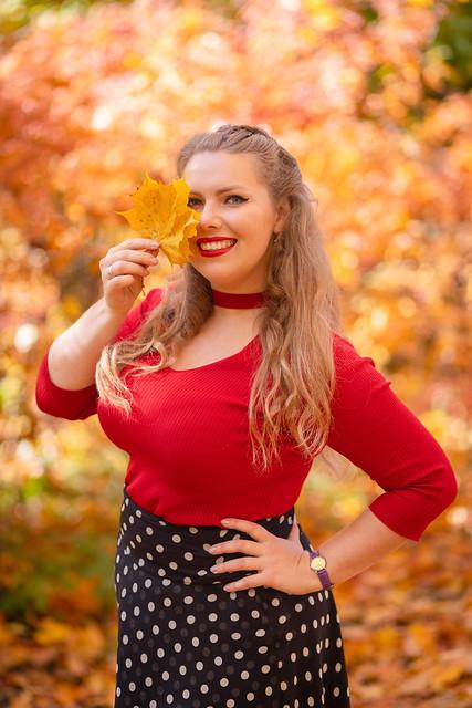 Girl in autumn wood