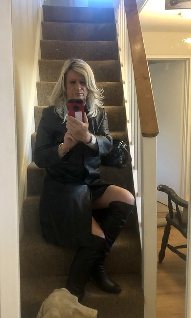 Leather boots, coat and skirt.