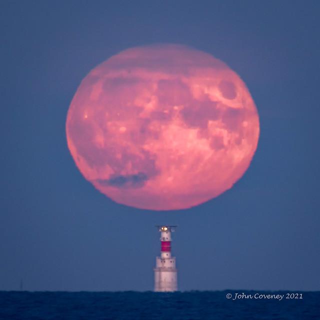 Hunter's Moon rising over the Kish Lighthouse off Dublin Bay, Ireland