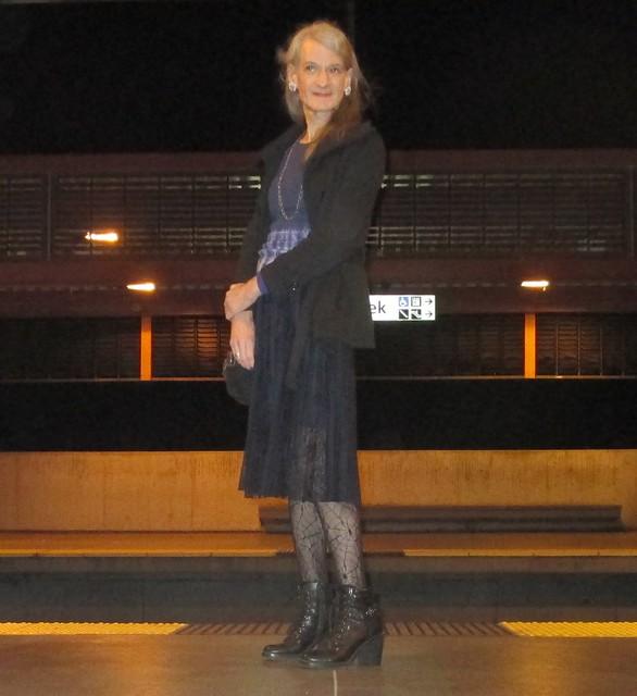 On the train platform at night