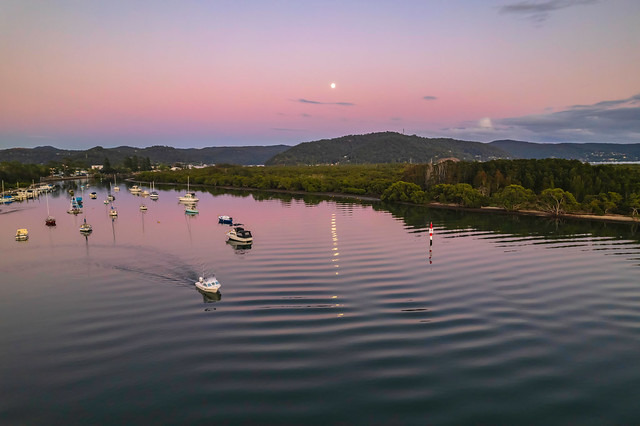 Pink dawn with moon waterscape