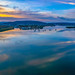 Sunrise and cloud reflections waterscape