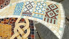 Mosaic tile artwork embedded in a sidewalk of Caernarfon, Wales
