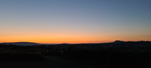 Sunset picture with the land in almost complete darkness