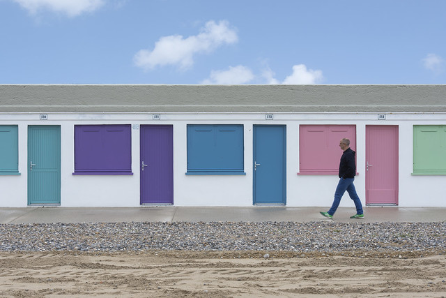 Man and beach cabins (on Explore)