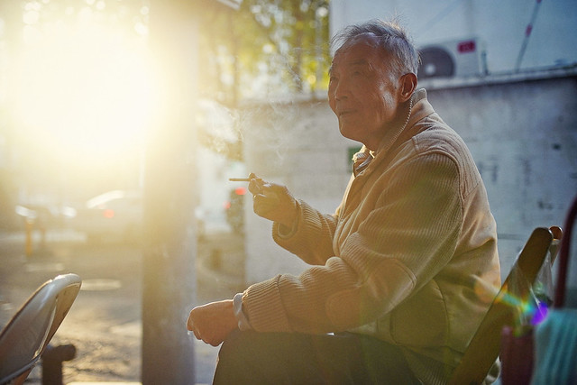 A portrait of an old man sit in the  afternoon sun-2