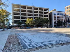 The former Cadillac service building, designed by Detroit architect Albert Kahn, is being converted into a hotel. First photo made possible by the demolition-by-neglect of another historic Motor Row building.
