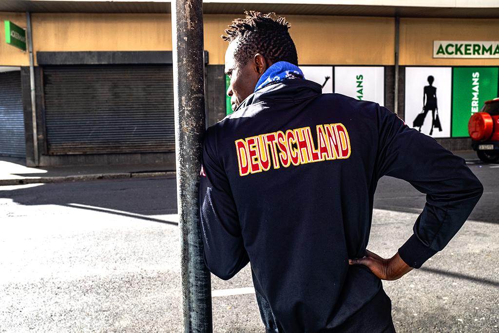 Man in DEUTSCHLAND jacket on 10-24-21--Cape Town copy