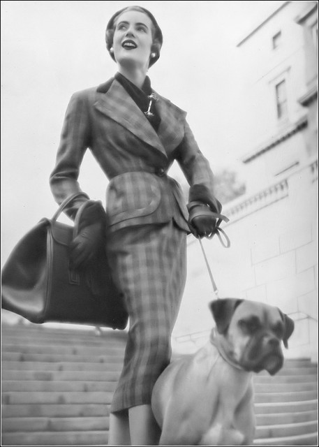 Pat O'Reilly in gray-and-white check tweed suit with green velveteen collar and cuffs by Victor Stiebel, photo by Richard Dormer, Harper's Bazaar UK, September 1950