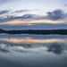 Sunrise panorama over the bay with cloud reflections