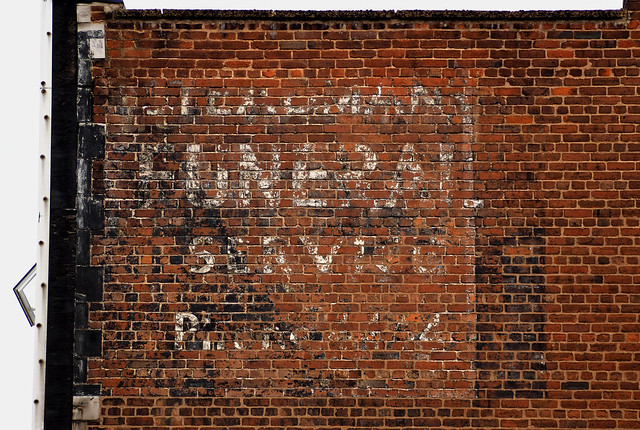 Funeral ghost sign