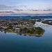 Merrillie posted a photo:Aerial sunrise waterscape after the rain with clouds reflecting on the bay at Woy Woy on the Central Coast, NSW, Australia.