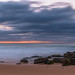 Low cloud covered sunrise seascape with rocks