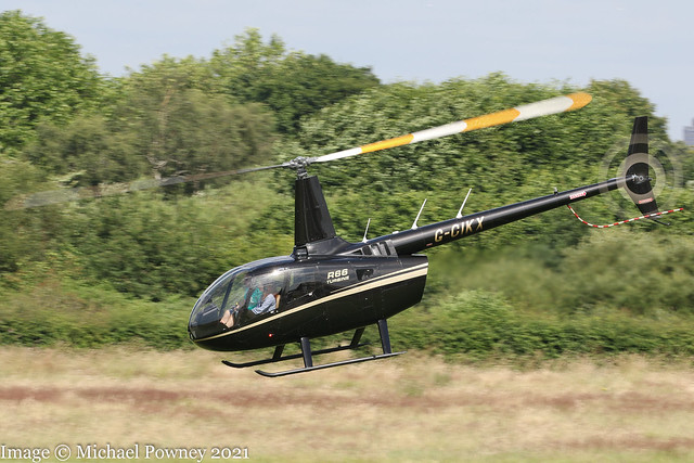G-CIKX - 2014 build Robinson R66 Turbine, departing from Barton after a brief fuel stop